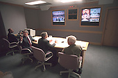 United States President George W. Bush, White House Chief of Staff Andy Card (left) and Admiral Richard Mies conduct a video tele-conference at Offutt Air Force Base in Bellevue, Nebraska, Tuesday, September 11, 2001..Mandatory Credit: Eric Draper - White House via CNP.