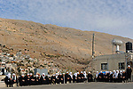 Druze sheikhs during the funeral of an elderly woman, in Majdal Shams, Golan Heights.