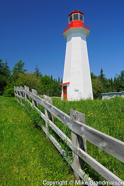 lighthouse and fence on Gulf of St. Lawrence<br /> Cap-de-Bon-Désir<br /> Quebec<br /> Canada