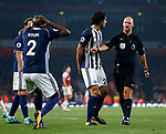 West Brom's Allan Nyom looks on dejected after Bobby Madley gives a penalty during the premier league match at the Emirates Stadium, London. Picture date 25th September 2017. Picture credit should read: David Klein/Sportimage