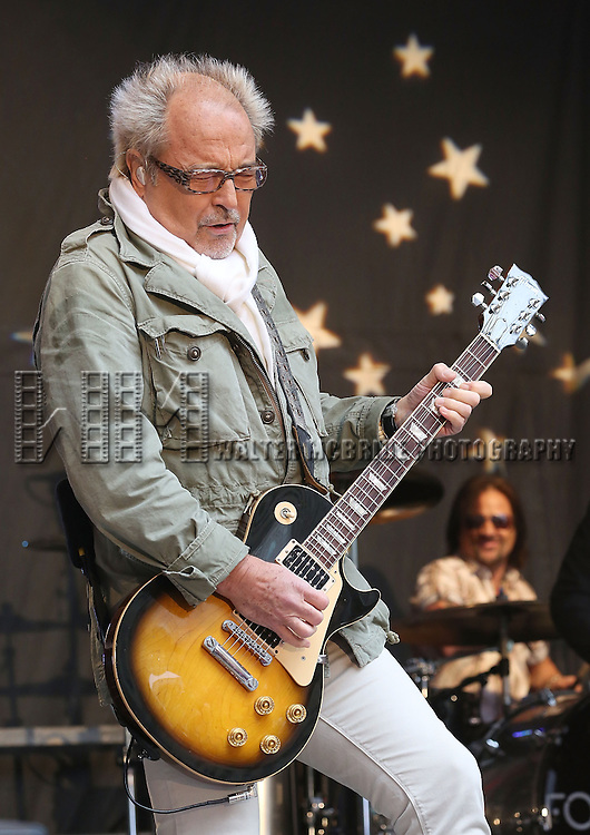 """NEW YORK, NY - JUNE 14:  Mick Jones of Foreigner performs at """"FOX & Friends"""" All American Concert Series outside of FOX Studios on June 14, 2013 in New York City.  (Photo by Walter McBride/FilmMagic)"""