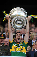 Killian Young lifts the Sam Maguire Cup to celebrate  Kerry's victory over Donegal in the All-Ireland Football Final against  in Croke Park 2014.<br /> Photo: Don MacMonagle<br /> <br /> <br /> Photo: Don MacMonagle <br /> e: info@macmonagle.com