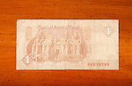 Egyptian one pound currency note on table with English script showing Abu Simbel