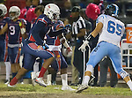 Lawndale, CA 10/14/16 - Danthony Jones (Leuzinger #4) and Javier Corral (North Torrance #65) in action during the North Torrance vs Leuzinger CIF League football game.