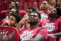 NWA Democrat-Gazette/CHARLIE KAIJO Arkansas Razorbacks guard Anton Beard (left) and forward Trey Thompson (right) watch the NCAA selection show, Sunday, March 11, 2018 at Bud Walton Arena in Fayetteville. The Razorbacks will play Butler in Detroit on Friday
