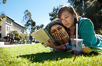 Sunny and 80 degrees is perfect weather for sipping an iced drink and relaxing on the grass. Not bad for January! Student - Maya Herzig '15. January 25, 2012. (Photo by Marc Campos, Occidental College Photographer)