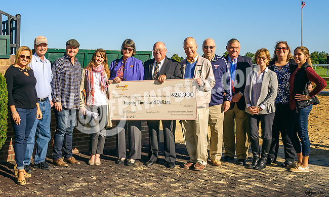 presentation of a $20,000 check payable to CANTER and Mid-Atlantric Horse rescue at Delaware Park on 10/15/16