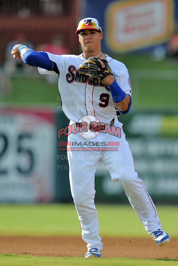 Tennessee Smokies shortstop Javier Baez #9 throws the ball to first during game one of a double header against the Huntsville Stars at Smokies Park on July 8, 2013 in Kodak, Tennessee. The Stars won the game 2-0. (Tony Farlow/Four Seam Images)