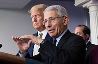 Director of the National Institute of Allergy and Infectious Diseases at the National Institutes of Health Dr. Anthony Fauci, speaks alongside US President Donald J. Trump during a briefing on the Coronavirus COVID-19 pandemic with other members of the Coronavirus Task Force in the Brady Press Briefing Room at the White House in Washington, DC, March 17, 2020, in Washington, D.C. <br /> Credit: Kevin Dietsch / Pool via CNP/AdMedia