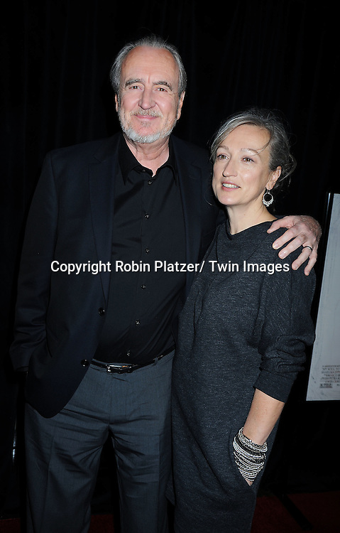 """writer/director/ producer  Wes Craven and wife Iya Labunkaposing for photographers at a special screening of """"My Soul to Take"""" on October 6, 2010 at The AMC Loews Lincoln Square in New York City."""