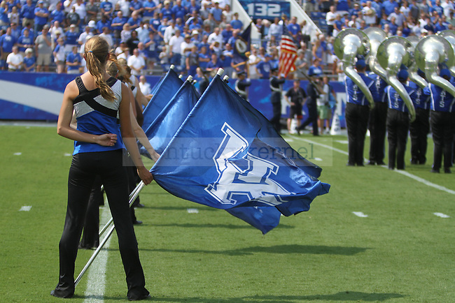 The University of Kentucky color guard stands in position for the national anthem before the first half of the University of Kentucky vs. University of Tennessee Martin football game at Commonwealth Stadium in Lexington, Ky., on Saturday, August 30, 2014. Photo by Jonathan Krueger | Staff