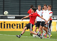 Germany coach Joachim Low has a shot during training ahead of tomorrow's World Cup Final