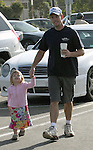 4-12-09 Exclusive.Kevin Dillon leaving Starbucks coffee in Malibu ca with his daughter. He purchased a copy of Us Weekly magazine at Hows market & was reading it in the parking lot with his dog..AbilityFilms@yahoo.com.805-427-3519.www.AbilityFilms.com