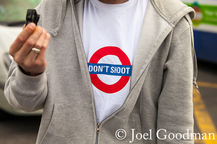"© Joel Goodman - 07973 332324 - all rights reserved . 17/07/2010 . Dudley , UK . A counter demonstrator at an English Defence League ( EDL ) demonstration in Dudley wearing a "" Don't Shoot "" London Underground t-shirt . Photo credit : Joel Goodman"