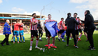 Lincoln City's Bruno Andrade, left, and Lincoln City's Shay McCartan celebrate after securing promotion from Sky Bet League Two<br /> <br /> Photographer Chris Vaughan/CameraSport<br /> <br /> The EFL Sky Bet League Two - Lincoln City v Cheltenham Town - Saturday 13th April 2019 - Sincil Bank - Lincoln<br /> <br /> World Copyright &copy; 2019 CameraSport. All rights reserved. 43 Linden Ave. Countesthorpe. Leicester. England. LE8 5PG - Tel: +44 (0) 116 277 4147 - admin@camerasport.com - www.camerasport.com