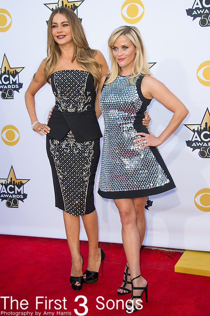 Reese Witherspoon and Sofia Vergara attend the 50th Academy Of Country Music Awards at AT&T Stadium on April 19, 2015 in Arlington, Texas.
