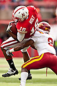 24 October 2009: Iowa State cornerback James Smith tackling Nebraska wide receiver Menelik Holt at Memorial Stadium, Lincoln, Nebraska. Iowa State defeats Nebraska 9 to 7.
