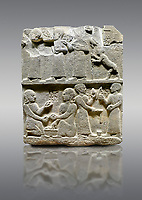 Picture &amp; image of Hittite monumental relief sculpted orthostat stone panel of Royal Buttress. Basalt, Karkamıs, (Kargamıs), Carchemish (Karkemish), 900 - 700 B.C. Anatolian Civilisations Museum, Ankara, Turkey.<br /> <br /> This panels scene showing 8 out of 10 children of the King, the hieroglyphs reads as follows: &quot;Malitispas, Astitarhunzas, Tamitispas,Isikaritispas, Sikaras, Halpawaris, Ya hilatispas&quot;. Above, there are three figures holding knucklebones (astragalus) and one figure walking by leaning on a stick; below are two each figures playing the knucklebones and turning whirligigs.  <br /> <br /> Against a gray background.