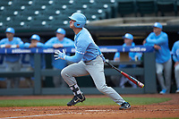 Michael Busch (15) of the North Carolina Tar Heels follows through on his swing against the Boston College Eagles in Game Five of the 2017 ACC Baseball Championship at Louisville Slugger Field on May 25, 2017 in Louisville, Kentucky. The Tar Heels defeated the Eagles 10-0 in a game called after 7 innings by the Mercy Rule. (Brian Westerholt/Four Seam Images)
