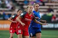 Seattle, WA - Saturday, July 1, 2017:  Emily Sonnett and Merritt Mathias during a regular season National Women's Soccer League (NWSL) match between the Seattle Reign FC and the Portland Thorns FC at Memorial Stadium.