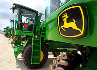 The John Deere logo marks the front of a newly-constructed model 7460 cotton picker at John Deere Des Moines Works in Ankeny.