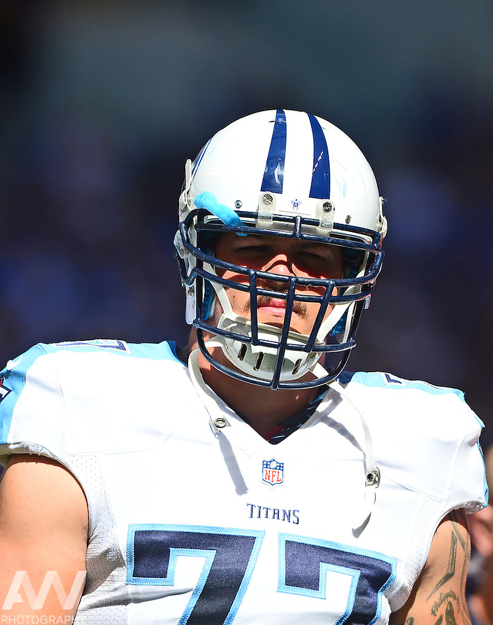 Sep 28, 2014; Indianapolis, IN, USA; Tennessee Titans tackle Taylor Lewan (77) against the Indianapolis Colts at Lucas Oil Stadium. Mandatory Credit: Andrew Weber-USA TODAY Sports