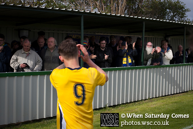 Home fans in the Tin Shed applauding their team from the pitch at Mount Pleasant after Marske United (in yellow) take on Billingham Synthonia in a Northern League division one fixture. Formed in 1956 in Marske-by-the-Sea, the home club had secured automatic promotion to the Northern Premier League two days before and were in the midst of a run of six home games in 10 days as they attempted to overtake Morpeth Town to win the league. They won this match 6-1 against already relegated Billingham, watched by a crowd of 196.