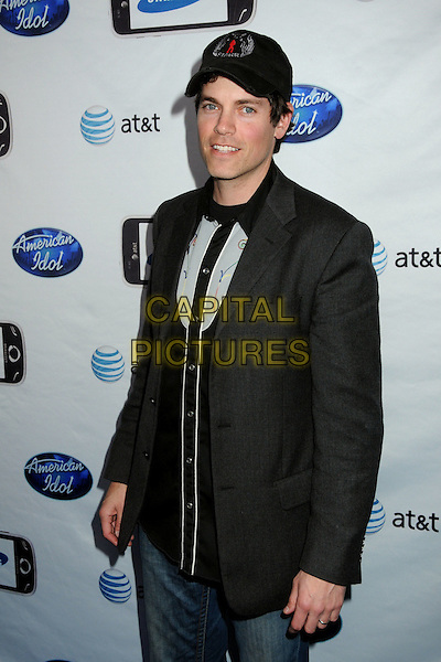 "EVAN LOWENSTEIN.""American Idol"" Top 24 Semi-Finalists Party held at STK, West Hollywood, California, USA..February 18th, 2010.half length black grey gray jacket baseball cap hat .CAP/ADM/BP.©Byron Purvis/AdMedia/Capital Pictures."