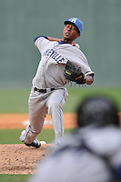 Pitcher Alexander Guillen (23) of the Asheville Tourists delivers a pitch in a game against the Greenville Drive on Sunday, April 10, 2016, at Fluor Field at the West End in Greenville, South Carolina. Greenville won, 7-4. (Tom Priddy/Four Seam Images)