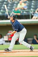 Justin Henry #17 of the Toledo Mud Hens follows through on his swing against the Charlotte Knights at Knights Stadium on May 7, 2012 in Fort Mill, South Carolina.  (Brian Westerholt/Four Seam Images)