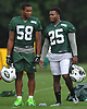 Darron Lee #58, left, chats with Shamarko Thomas #25 during New York Jets Training Camp at the Atlantic Health Jets Training Center in Florham Park, NJ on Thursday, Aug. 10, 2017.
