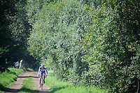 From early on the peloton gets decimated in smaller groups and lone riders as many can't cope with the muddy roads. Soon they will have to abandon the race, because the narrow, treacherous roads don't allow for much 'come-backs'... <br /> <br /> 90th Schaal Sels 2015