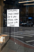 A sign indicates changed store hours at a convenience store due to the ongoing Coronavirus (COVID-19) global pandemic in Belmont, Massachusetts, on Tue., April 7, 2020.