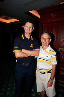 "John ""Ronnie"" Roberts, ex RAPC, presents Justin Rose (ENG) with a special US Open Champion 2013 shirt commissioned by the Royal Army Pay Corps after Friday's Round 2 of the 2014 BMW Masters held at Lake Malaren, Shanghai, China 31st October 2014.<br /> Picture: Eoin Clarke www.golffile.ie"