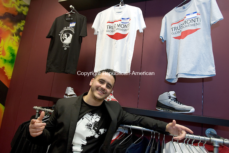WATERBURY, CT. 27 February 2012-022712SV15-Brandon Monti, a college student from Waterbury, launched his own line of clothing, a percentage of proceeds from which schools in Africa, as well as the U.S., will benefit. The clothing line is being sold at The Stash House store in the Brass Mill Center in Waterbury. .Steven Valenti Republican-American