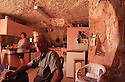 "Miner /tour operator and his wife in their ""dugout"" or home. Coober Pedy, South Australia"