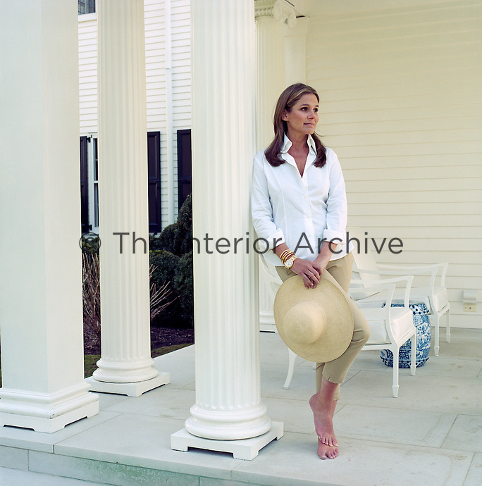 Portrait of Aerin Lauder Zinterhofer, senior vice-president and creative director of Estée Lauder, on the porch of her Greek Revival summer house on Long Island