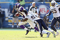 09/11/11 San Diego, CA: Minnesota Vikings running back Adrian Peterson #28 and San Diego Chargers linebacker Takeo Spikes #51during an NFL game played at Qualcomm Stadium between the San Diego Chargers and the Minnesota Vikings. The Chargers defeated the Vikings 24-17.