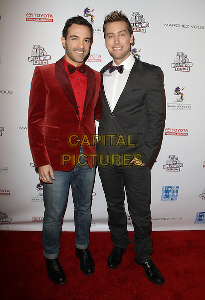 George Kotsiopoulos & Lance Bass.2nd Annual Hollywood Rush Benefiting The Baby Dragon Fund held at The Wilshire Ebell Theatre, Los Angeles, California, USA..February 19th, 2012.full length red velvet jacket jeans denim tuxedo white shirt.CAP/ADM/KB.©Kevan Brooks/AdMedia/Capital Pictures.