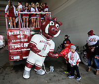 NWA Media/ J.T. Wampler - Boss Hog visits with fans Saturday Oct. 11, 2014.
