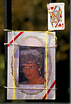 MEMORIAL TO DIANA CONSISTING OF A PHOTO CARD OF THE PRINCESS OF WALES & A QUEEN OF HEARTS PICTURE PLAYING CARD WITH THE MESSAGE TO HER SONS; (PRINCE) 'WILLIAM & HARRY YOUR MUM WILL ALWAYS BE THE, 1997