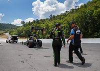 Jun 17, 2017; Bristol, TN, USA; Crew member with NHRA top fuel driver Brittany Force during qualifying for the Thunder Valley Nationals at Bristol Dragway. Mandatory Credit: Mark J. Rebilas-USA TODAY Sports