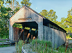 Photo taken at sunrise of a covered bridge in Conway, Massachusetts, built in 1869 and placed on the National Register of Historic Places in 1988.