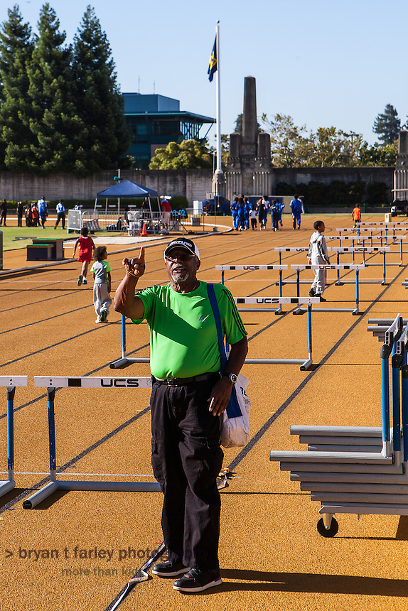 Coach Willie White preparing for the 2013 Tommie Smith Youth Track Meet at Edwards Stadium on the University of California Berkeley campus on Saturday June 1, 2013. Coach White, a 1960 NCAA All-American, was inducted into the Cal Athletic Hall of Fame in 2000. The 2013 Tommie Smith Youth Track Meet was held at Edwards Stadium on the University of California Berkeley campus on Saturday and Sunday June 1-2, 2013. Tommie Smith broke the 200 meter world record at the 1968 Mexico City Olympics and became an international symbol for human rights when he received his Gold Medal.