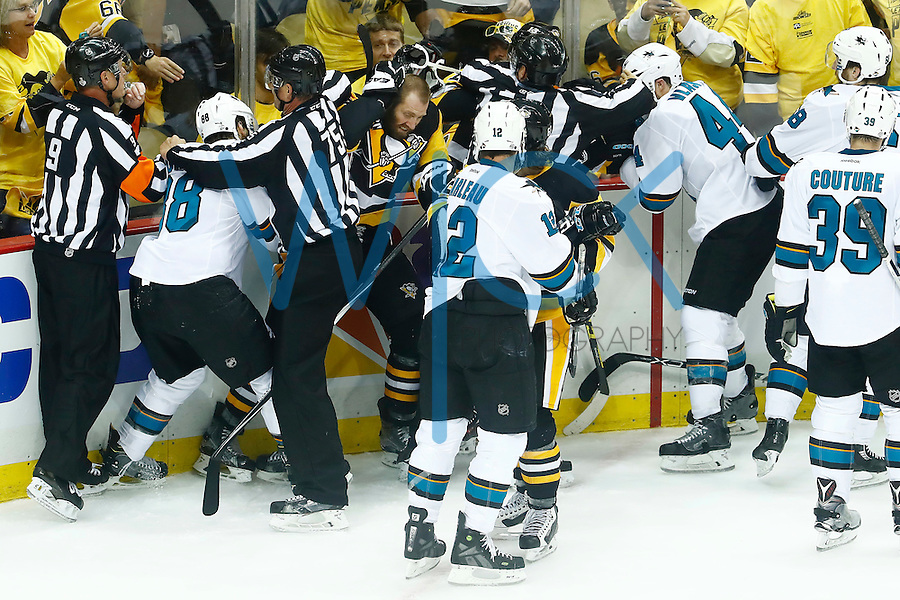 Eric Fehr #16 of the Pittsburgh Penguins gets tangled up with members of the San Jose Sharks in the third period during game five of the Stanley Cup Final at Consol Energy Center in Pittsburgh, Pennsylvania on June 9, 2016. (Photo by Jared Wickerham / DKPS)