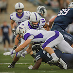 8 October 2016: Amherst College Purple & White Defensive Lineman Isaiah Holloway, a Senior from Oakdale, CT, in action against the Middlebury College Panthers at Alumni Stadium in Middlebury, Vermont. The Panthers edged out the Purple & While 27-26. Mandatory Credit: Ed Wolfstein Photo *** RAW (NEF) Image File Available ***