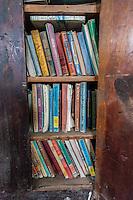 Old schoolbooks inside abandoned school in Boyes, MT