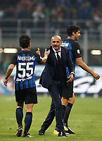 Calcio, Serie A: Milano, stadio Giuseppe Meazza, 15 ottobre 2017.<br /> Inter's coach Luciano Spalletti (r) celebrates with Inter's Yuto Nagatomo (l) after winning 3-2 the Italian Serie A football match between Inter and Milan at Giuseppe Meazza (San Siro) stadium, October15, 2017.<br /> UPDATE IMAGES PRESS/Isabella Bonotto