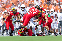 Landover, MD - September 1, 2018: Texas Longhorns defensive back Brandon Jones (19) is tackled by Maryland Terrapins linebacker Isaiah Davis (22) and Maryland Terrapins defensive back Kenny Bennett (24) during a kickoff return between Maryland and No. 23 ranked Texas at FedEx Field in Landover, MD. The Terrapins upset the Longhorns in back to back season openers with a 34-29 win. (Photo by Phillip Peters/Media Images International)