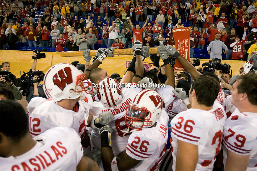 MINNEAPOLIS, MN - NOVEMBER 17: The Wisconsin Badgers grab the Paul Bunyan Axe after the game against the Minnesota Golden Gophers at the Hubert H. Humphrey Metordome on November 17, 2007 in Minneapolis, Minnesota. The Badgers beat the Gophers 41-34. (Photo by David Stluka)
